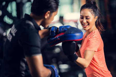 personal trainer is practicing boxing Stock Photo