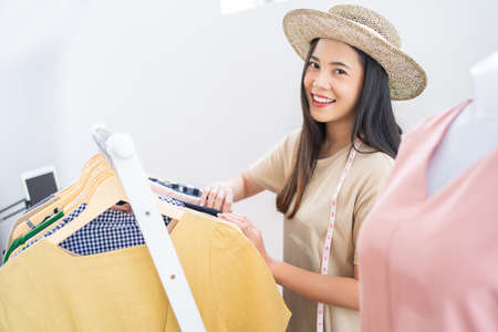 Asian woman selling vintage clothes