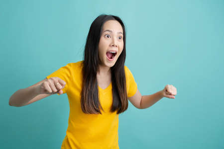 Asian woman making an excited expression