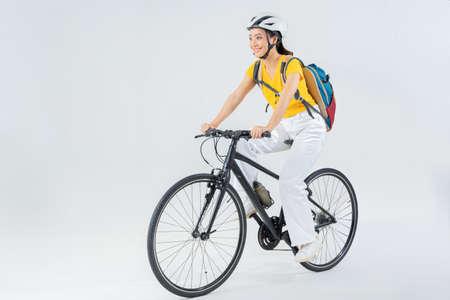 Asian beautiful woman, she is riding a city bike to work. 版權商用圖片 - 157341002