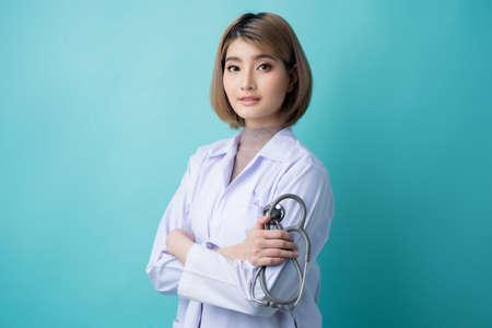 Portrait of a beautiful Asian doctor in a studio