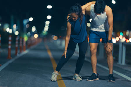Asian couple, they exercise. And he was injured Stock fotó