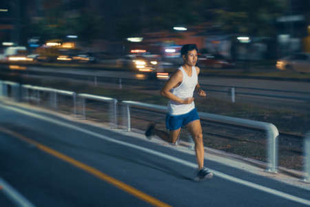 Asian man exercise practicing running at night