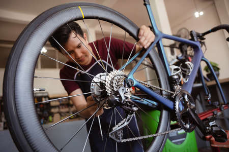 Repair technician bicycles was repaired gear bike shop.