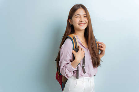 Asian female student carrying a bag, smiling beauty