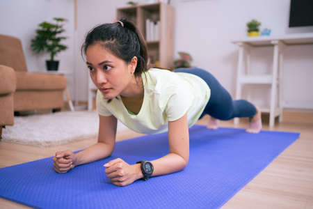 Asian beautiful woman, she exercises at home, she does pank