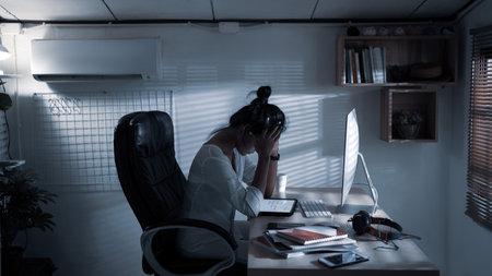 Asian woman working at home in the dark 版權商用圖片
