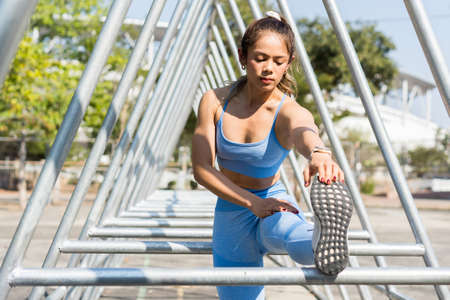 Asian woman Stretching Before exercise