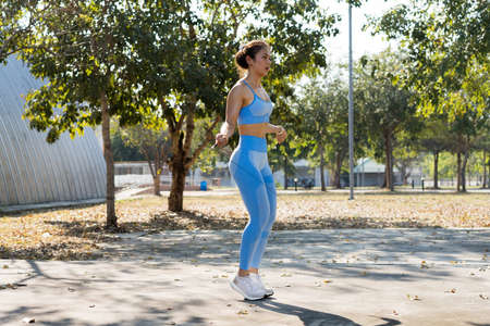Asian woman Cardio exercise with jumping rope 版權商用圖片