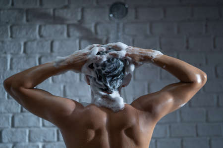 Handsome asian guy Taking a shower in the bathroom He is washing his hair