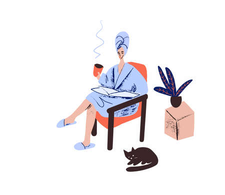 Young woman with a cup of tea in hand sitting on an armchair and reading a newspaper. Girl in a bathrobe with a towel on her head.