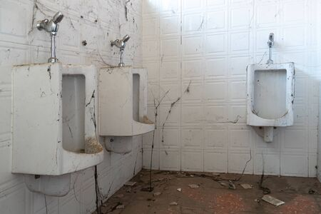 Abandoned toilet. a lot of cobwebs and garbage in abandoned toilet.