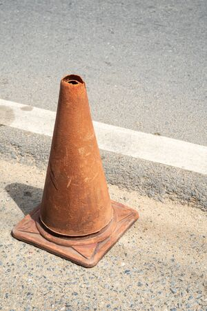 Old Traffic cones, also called pylons, witches' hats, road cones, highway cones, safety cones, channelizing devices, or construction cones