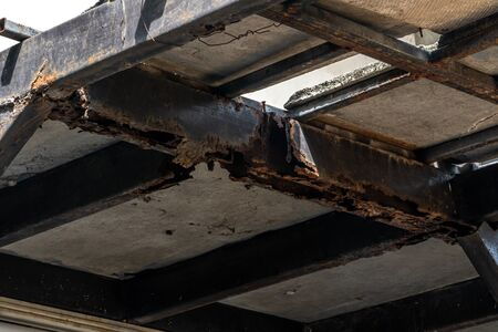 Rust on steel structural columns & post floor support.
