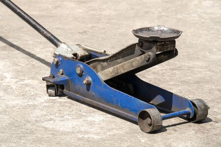 Used hydraulic vehicle jack or vehicle lifting for inspection of vehicle underbody, brake repairs.