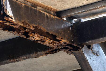 Rust on steel structural columns & post floor support.