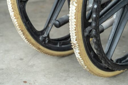 Degenerate flat-free tires of old wheelchair. Wheelchair tyres get worn out with time.