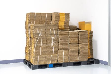 stack of flat pack cardboard boxes for product packaging and delivery.