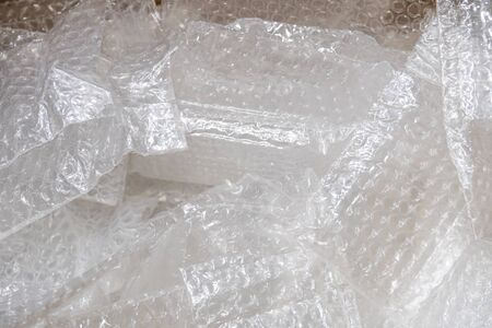 used bubble plastic bag in paper box for recycling. Banco de Imagens