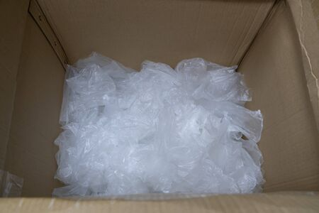 used plastic bag in paper box for recycling. Banco de Imagens