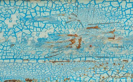 Close-up, the surface tuxture of the truck's metal panel is full of rust and crack