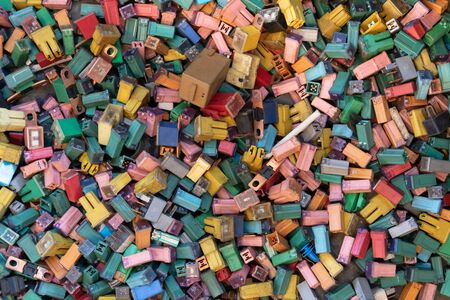 many color and size of automobile fuse for recycling.