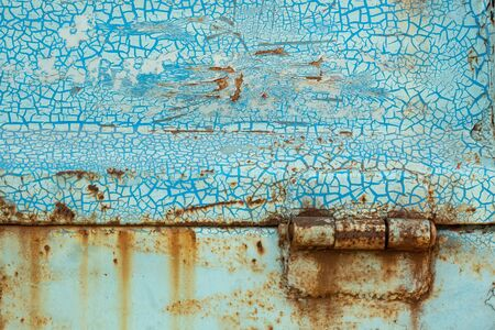 Close-up, the surface tuxture of the trucks metal panel is full of rust and crack