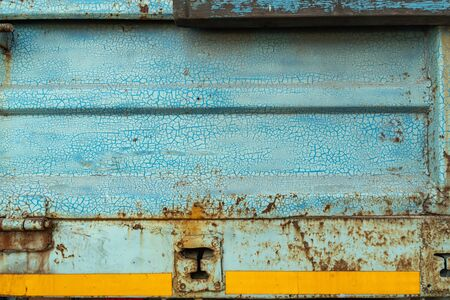 Close-up, the surface tuxture of the trucks metal panel is full of rust 写真素材