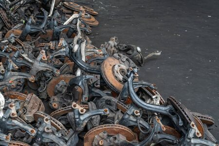 used brake rotor and car part at junkyard or scrapyard for recycling