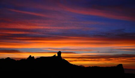 Spectacular sunset from the natural park Roque Nublo, Gran canaria, Canary islands photo