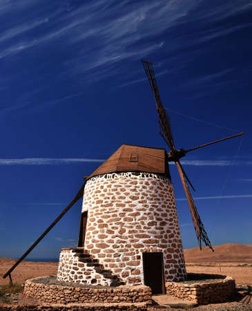gristmill: Wind mill of Fuerteventura on bright blue sky, Canary islands