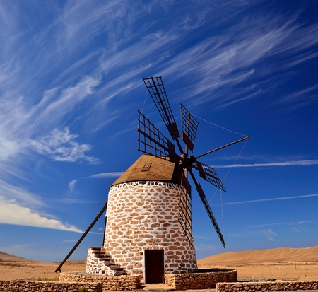 gristmill: Traditional wind mill on intense blue sky, Fuerteventura, canary islands Stock Photo