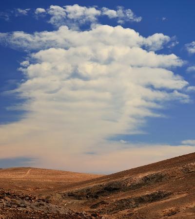 peculiar: Landscape with peculiar cloud and blue sky