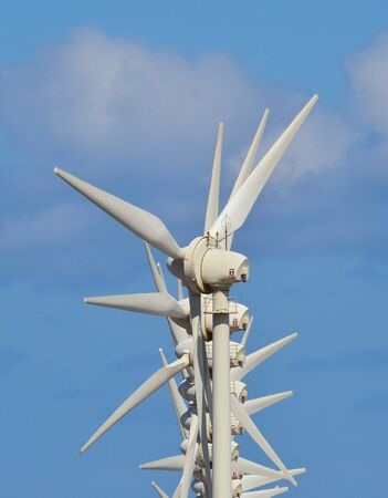 sustainably: Wind turbines on blue sky and clouds
