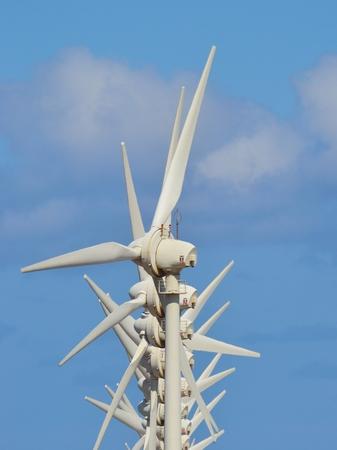 sustainably: Wind turbines on blue sky