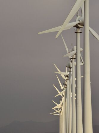 sustainably: Line of wind turbines Stock Photo