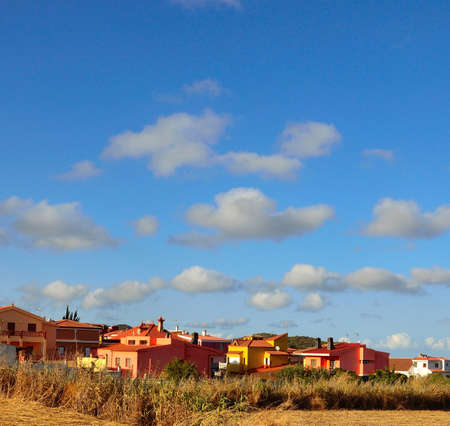 sustainably: Blue sky with scattered clouds on colorful houses Stock Photo