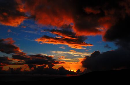 atmospheric phenomena: Blue sky and intense color clouds at dawn