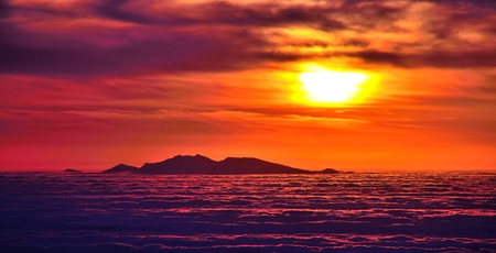 intense: Sunrise with intense colors on Fuerteventura island among clouds