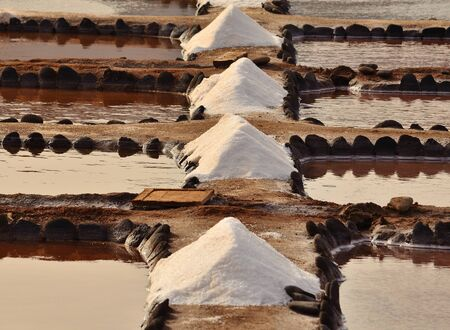 mounds: Mounds of salt obtained in saline of mud and stones Stock Photo
