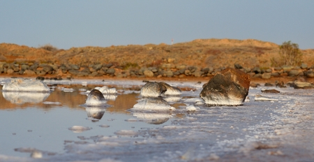seawater: Seawater lagoon and stones covered with salt Stock Photo