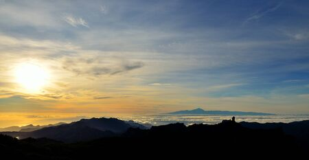 gloaming: Sunset from the Canary islands with Roque Nublo and Tenerife island in background