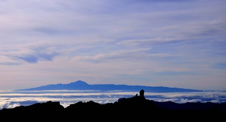 chromatic: Sunset from summit of Gran canaria, Roque Nublo and Tenerife island in background, Canary islands Stock Photo