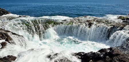 spontaneous: Spontaneous waterfall in natural pool at high tide, coast of Telde, Gran canaria, Canary islands