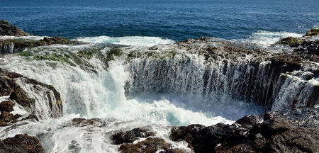 natural pool: Spontaneous waterfall in natural pool at high tide, coast of Telde, Gran canaria, Canary islands