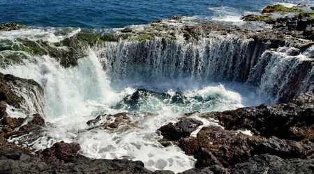 water ecosystem: Spontaneous waterfall in natural pool at high tide, coast of Telde, Gran canaria, Canary islands