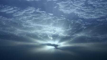 atmospheric phenomena: Amazing dawn with sunrays through the clouds