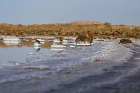 seawater: Saltwater lagoon with many stones in the shore Stock Photo