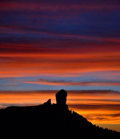 Roque Nublo and multicolored sky at sunset, Canary islands