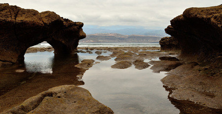 Coast landscape among the rocks with low tide, El Confital, Las Palmas de Gran Canaria 免版税图像